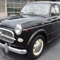 Black with books: 1957 Fiat 1100 E