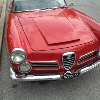 In the middle: 1963 Alfa Romeo 2600 Spider by Touring